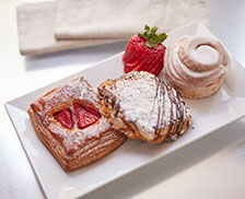 SENZA Hotel Dining - Assorted pastries and strawberries