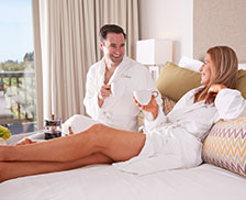 SENZA Hotel Rooms - Couple relaxing in Vineyard King