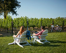 SENZA Hotel - Couple relaxing with view overlooking vineyards