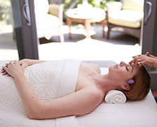 SENZA Hotel Spa - Woman getting a Facial treatment